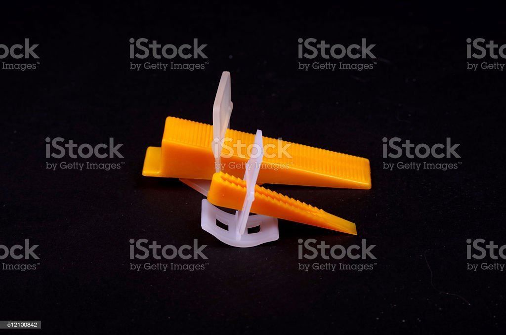 https www istockphoto com photo tile levelling system tool wedge and clip gm512100842 86981261