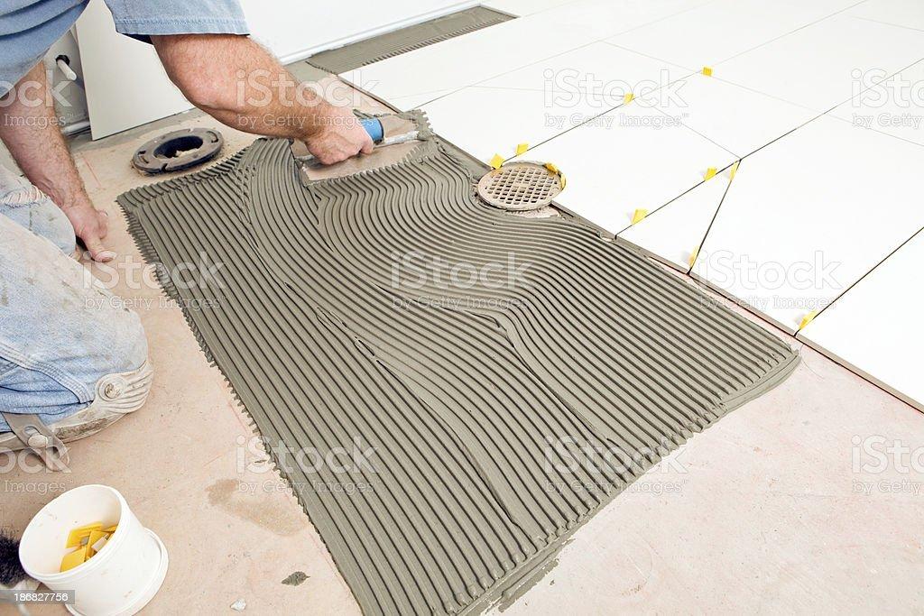 https www istockphoto com photo tile setter troweling mortar on a concrete floor gm186827756 14307571