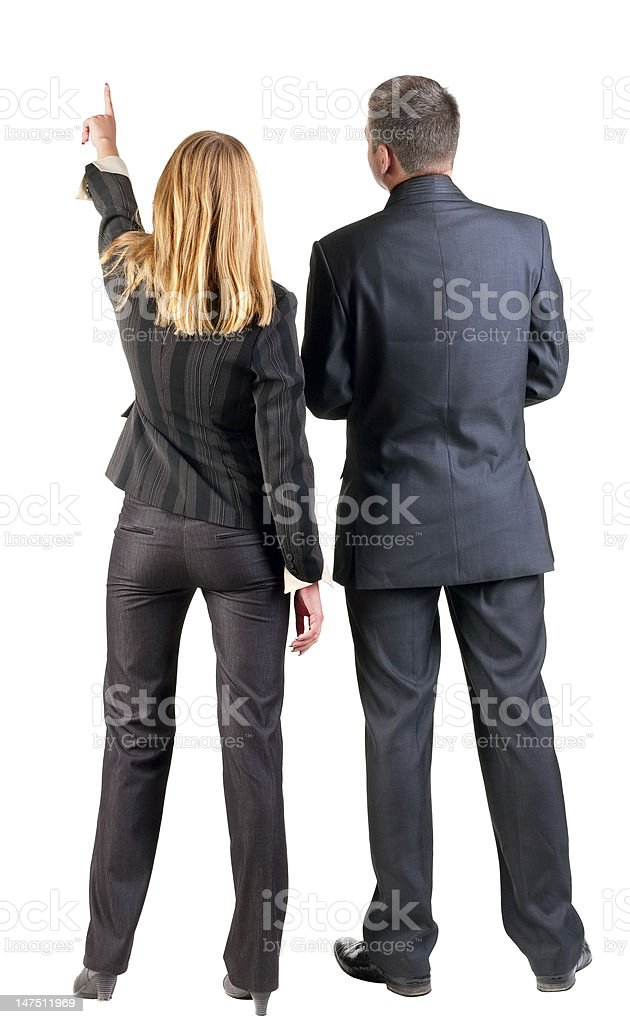 Two Business People Facing Away While The Woman Points