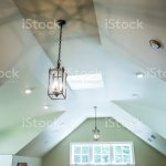 Vaulted Ceiling With A Modern Gothic Mid Evil Iron Metal Hanging Lights And A Green Walls Stock Photo Download Image Now Istock