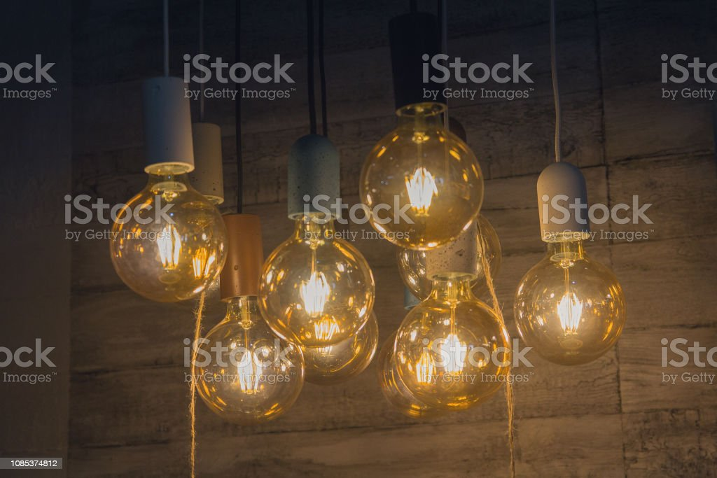https www istockphoto com photo vintage style light bulbs hanging from the ceiling gm1085374812 291243067
