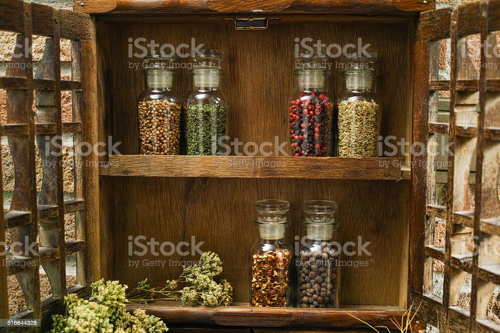 https www istockphoto com photo vintage wooden spice rack or storage cabinet gm516844328 89183149