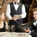 Waiter Taking Couples Order At A Fancy Restaurant Stock Photo Download Image Now Istock