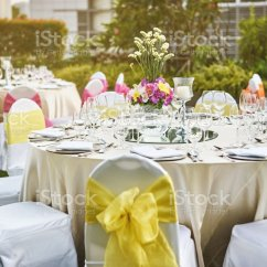 Wedding Decorations Chairs Receptions Cheap Banquet Chair Covers Wholesale Reception Dinner Table Setting With Flower Decoration And White Cover Yellow Sash Stock Image