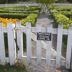 welcome sign on garden gate stock photo more pictures of boxwood
