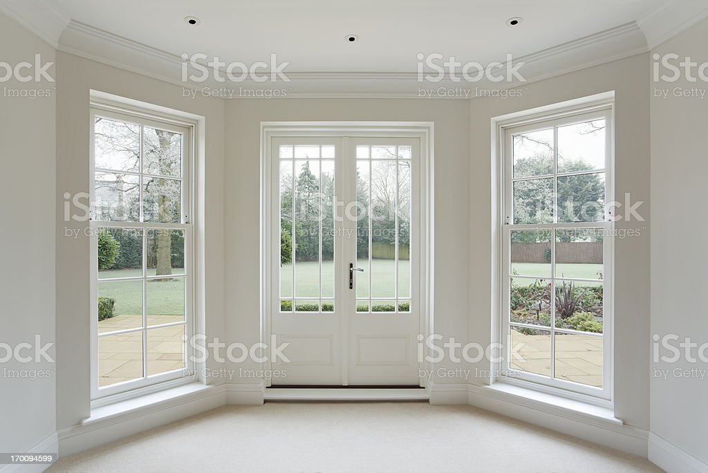 White Bay Windows And French Doors Stock Photo & More