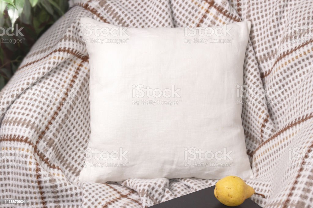 white linen pillow on a chair in cozy room mockup stock photo download image now istock