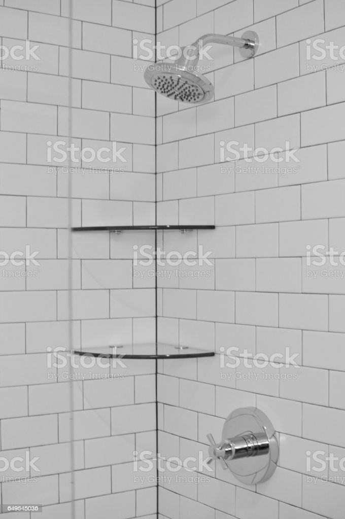 white subway tiles with shelves in shower stock photo download image now istock