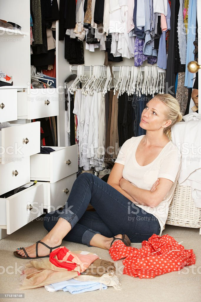 Women Choosing Clothes From Wardrobe In Bedroom Stock Photo Download Image Now Istock