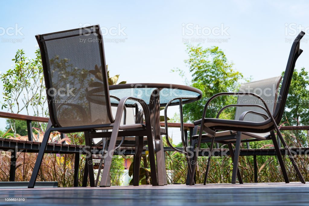 wooden and steel of patio furniture set on brown wooden green grass field background stock photo download image now istock