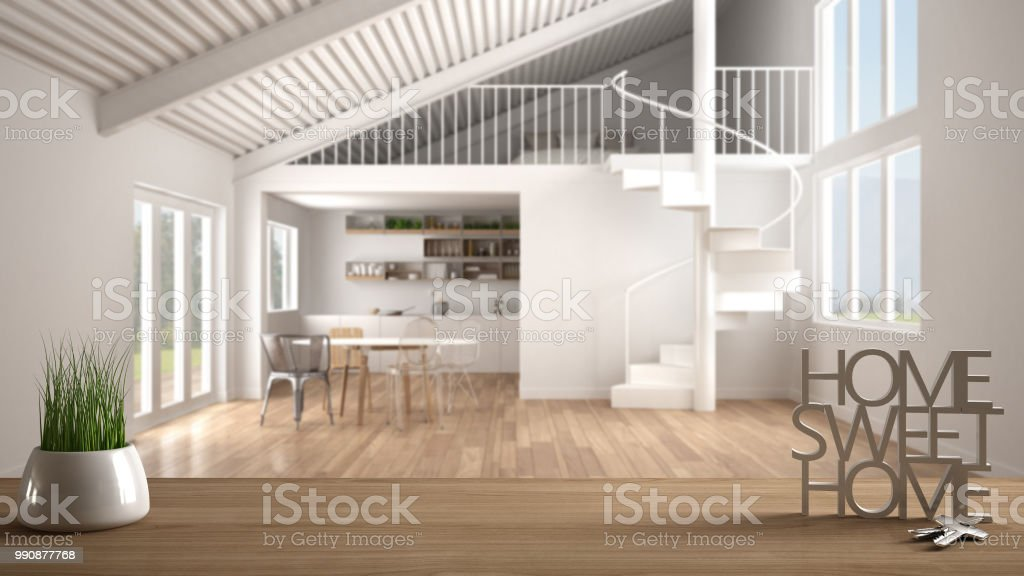 There's not really enough to go hear some of just just still walls. Wooden Table With Potted Plant House Keys And 3d Letters Home Sweet Home Over Blurred Open Space With Kitchen Mezzanine And Spiral Staircase Background Interior Design Stock Photo Download Image Now
