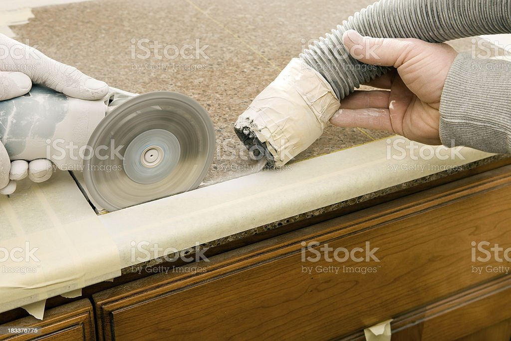 https www istockphoto com photo workers cutting sink hole in a granite countertop gm183376775 15078539