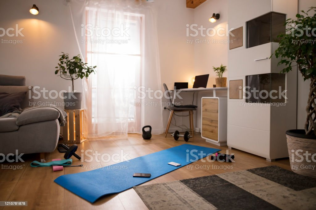 Yoga Mat And Weights On Living Room Floor Stock Photo Download Image Now Istock