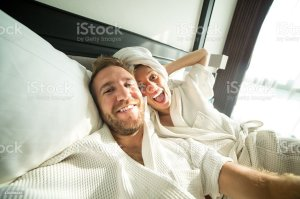 selfie couple hotel taking young cheerful istock