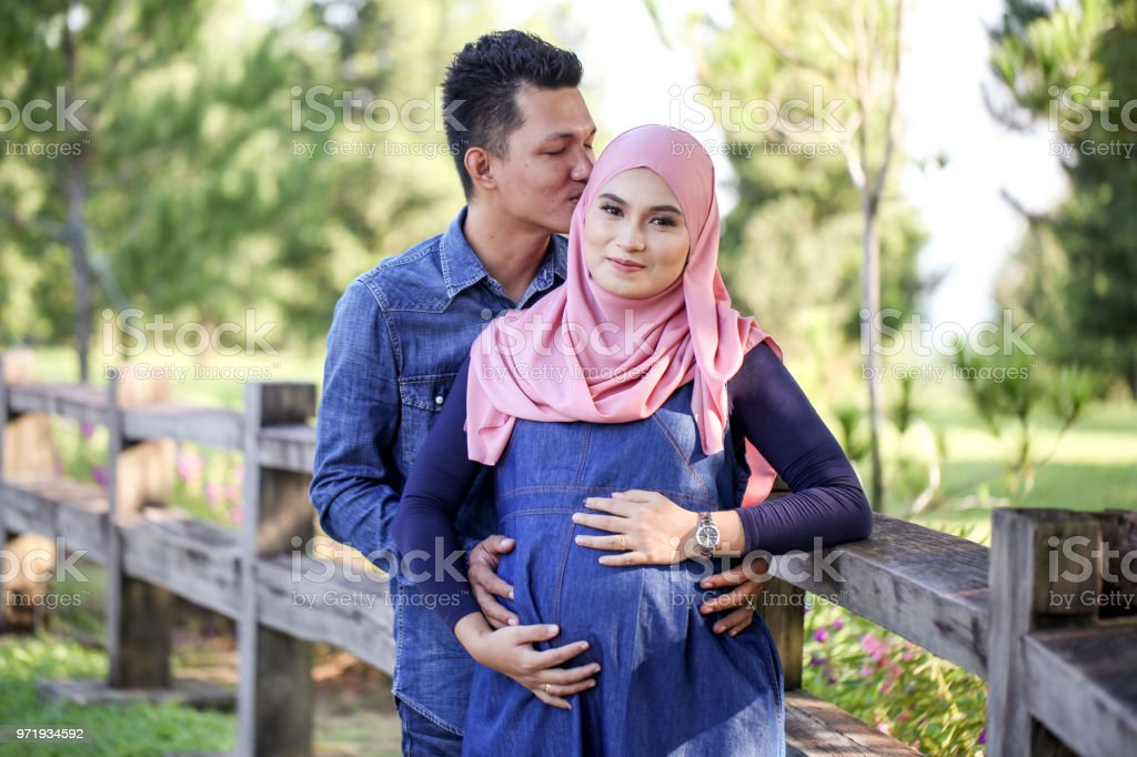 Download and use 5000+ hijab stock photos for free. Young Couple Pregnant Women With Husband Stock Photo Download Image Now Istock