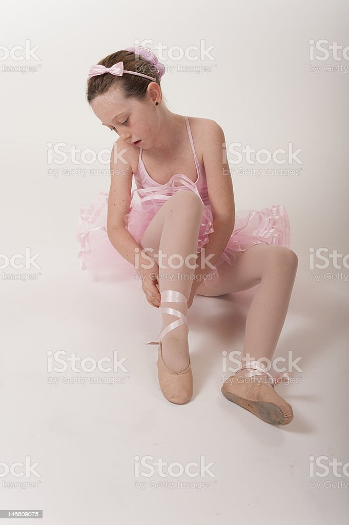 young girl ballerina tying