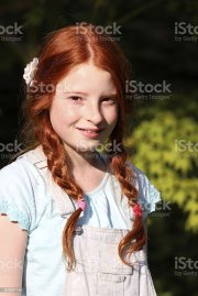 young girl with red hair long pigtails
