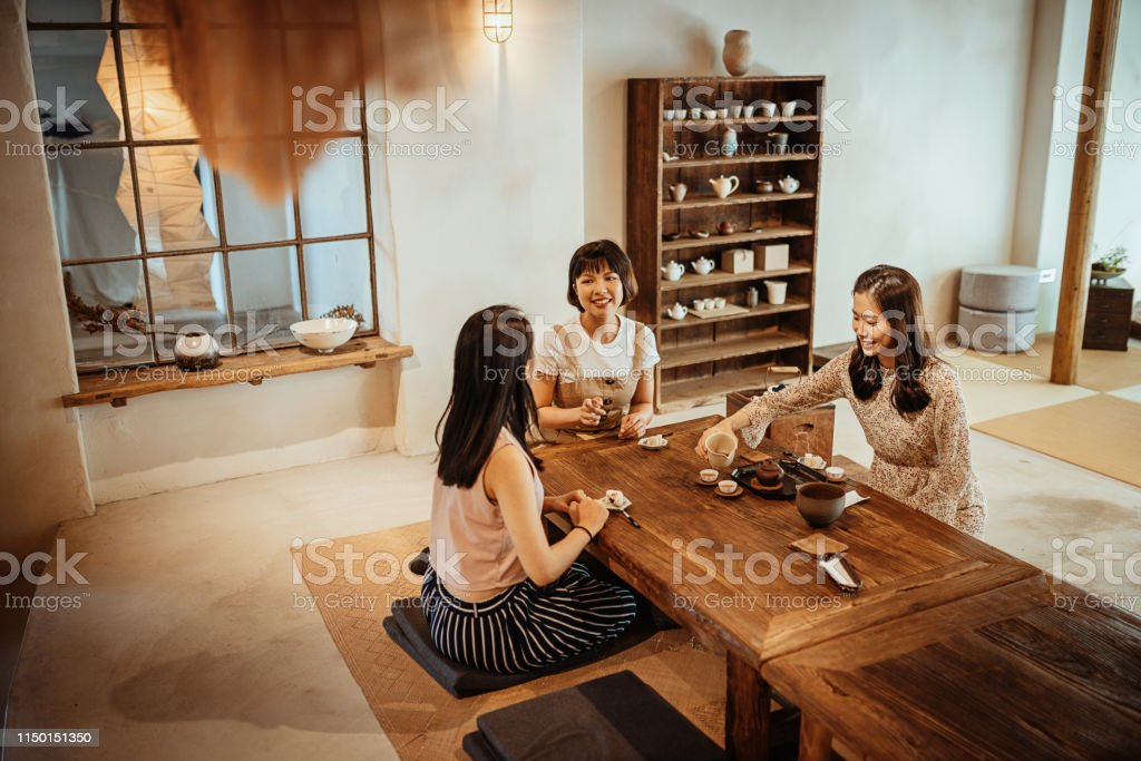 Young Taiwanese Women Enjoying Weekend Together And Drinking