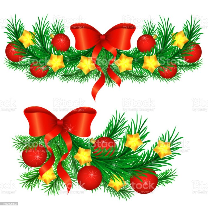 Sprigs of Christmas tree decorated with gold stars and red balls.  royalty-free sprigs