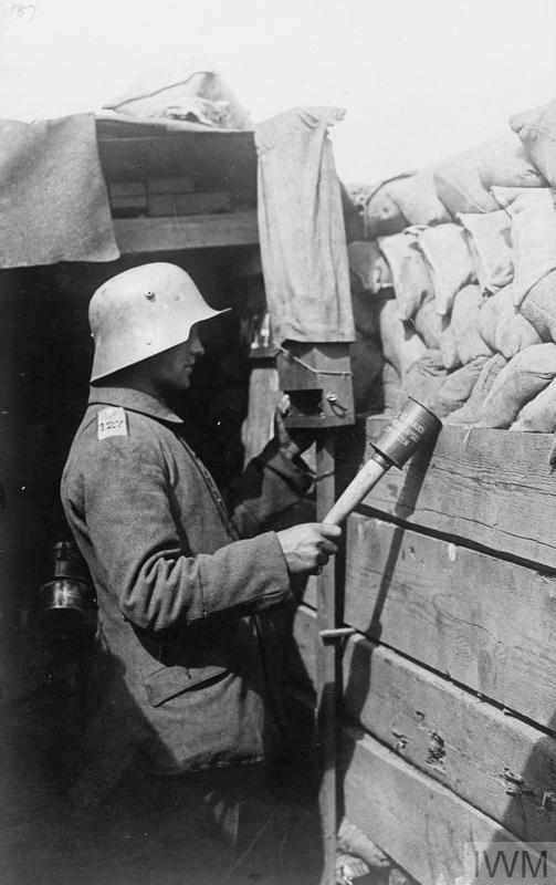 SENTRY USING A PERISCOPE IN TRENCH Imperial War Museums