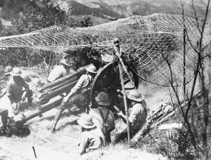 British 18-pdr field gun firing from a camouflaged position on the Doiran Front. BRITISH FORCES IN THE SALONIKA CAMPAIGN 1915-1918