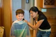 mother cutting son hair