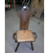 High backed chair with leather cushion