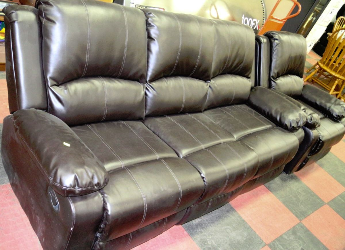 black reclining sofa with console genuine leather bed canada new leatherette chair