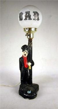 A CHARLIE CHAPLIN PAINTED BAR LAMP Losses, together with a ...