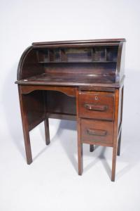 A Vintage Child's Roll Top Desk and Chair.