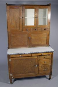 An Arts and Crafts Style Oak Hoosier Cabinet.