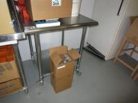 Small stainless steel table on wheels