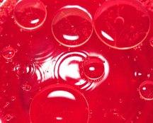 rött olja bubblor