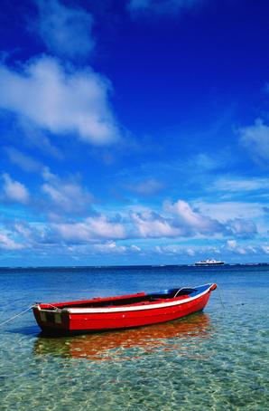 Small boat at anchor.
