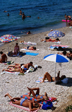 Sunbather on beach, Palaio Faliro .