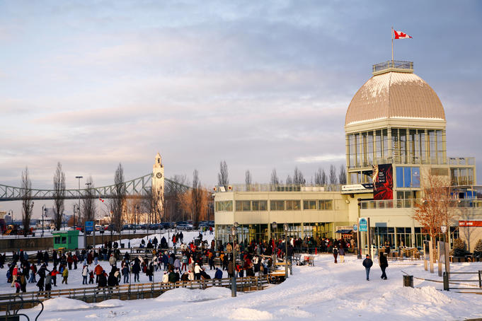 Domed building with Canadian flag flying, Parc du Bassin Bonsecours, with Sailor's Memorial Clocktower in background.