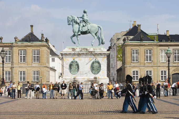 Changing of the guard and statue of Frederik V, Amalienborg Slot Castle.
