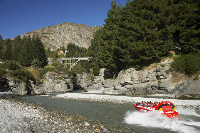 Shotover Jetboat powering along the Shotover River.