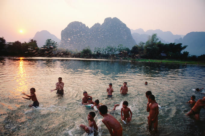 Children swimming - Song River, Vang Vieng.