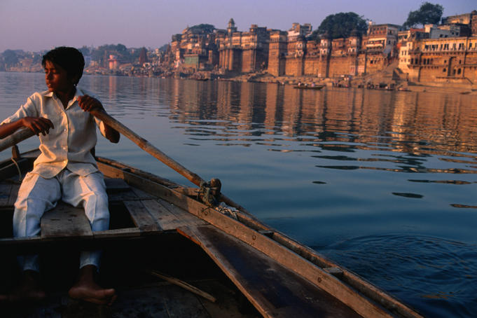 A young boatsman rows the sacred River Ganges in Varanasi.