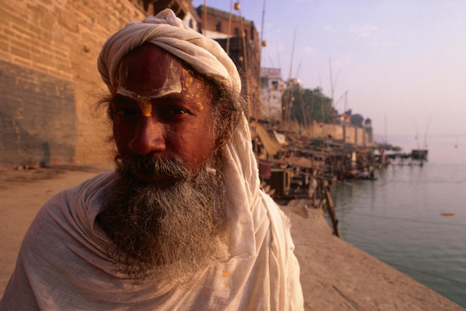 A peacful Sadhu, worshipper of Vishnu, sits quietly by the River Ganges in Varanasi.