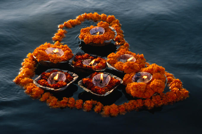 Garlands of flowers and floating candles are often seen on the river Ganges. They are given as offerings to Ganga, who is revered as a living goddess- Varanasi, Uttar Pradesh, India