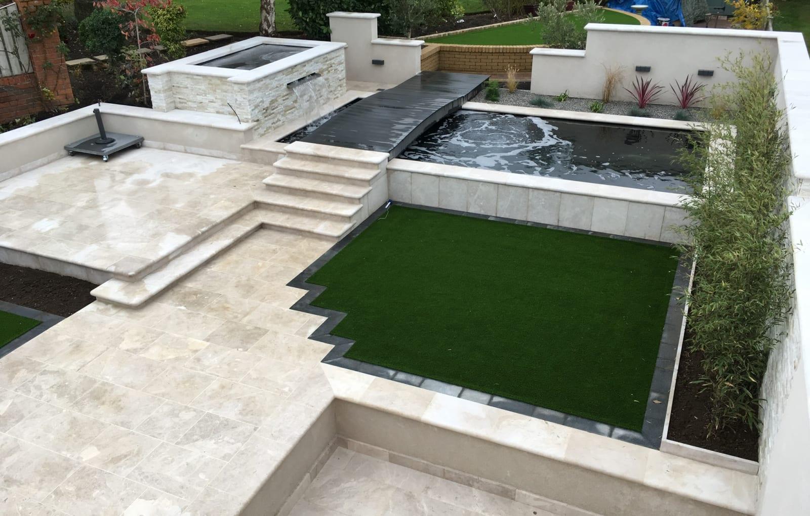 multi level patio featuring a koi pond