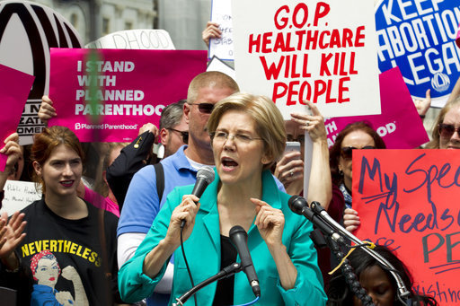 Image result for photos of senators pushing for healthcare law
