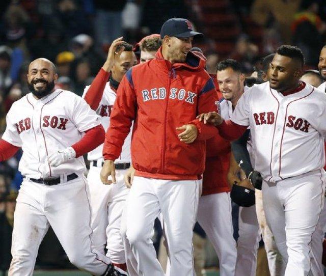 Boston Red Soxs Sandy Leon Left Celebrates With Teammates Including Rick Porcello Center