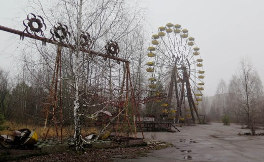 The swings and Ferris wheel remain in an amusement park that was scheduled to open on May 1, 1986, for the Soviet May Day celebrations in Pripyat, Ukraine. It never opened. // Claudia Himmelreich / McClatchy