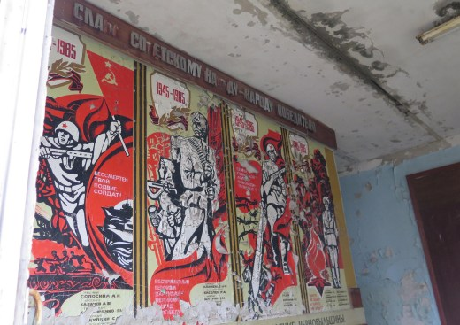 Inside Pripyat's School No. 1 in Ukraine, old Soviet posters celebrate the 40th anniversary of victory over fascism. The city was abandoned a day after the Chernobyl disaster, April 26, 1986. // Claudia Himmelreich / McClatchy