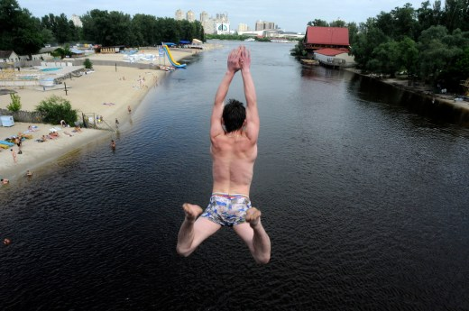 A young man jumps into the Dnieper River from the Venetian Bridge in Kiev, Ukraine. If Chernobyl's Reactor No. 4 and the nuclear waste are not contained from the accident, the Dnieper River could become contaminated. The Dnieper is the source of water for Kiev, the country's capital. // Sergei Chuzavkov / AP