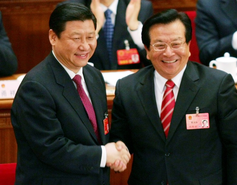 New Chinese Vice President Xi Jinping, left, is congratulated by outgoing Vice President Zeng Qinghong after Xi was elected during a session of the National People's Congress in Beijing's Great Hall of the People on March 15, 2008. // Greg Baker / AP