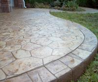 Deck And Stamped Concrete Patio - Modern Home Exteriors